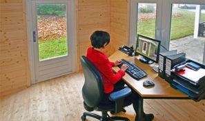 A home office in a log cabin.